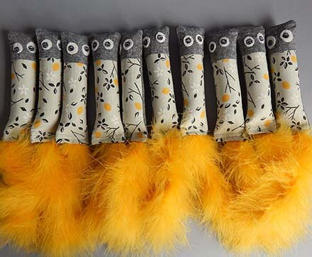 A row of Buddy Cat cloth and feather toys