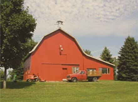 An old red painted barn, symbol of Red Barn