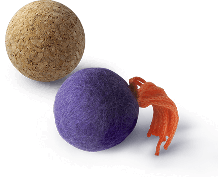 A cork ball and a felt ball cat toys