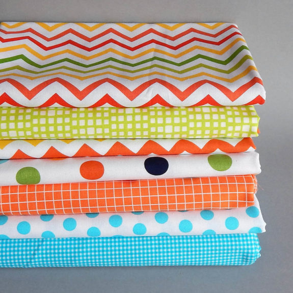 stack of brightly colored calico fabric