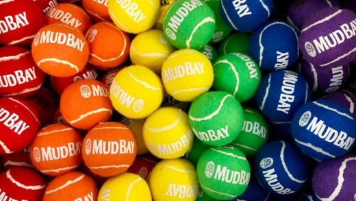 red, orange, yellow, green, blue and purple tennis balls